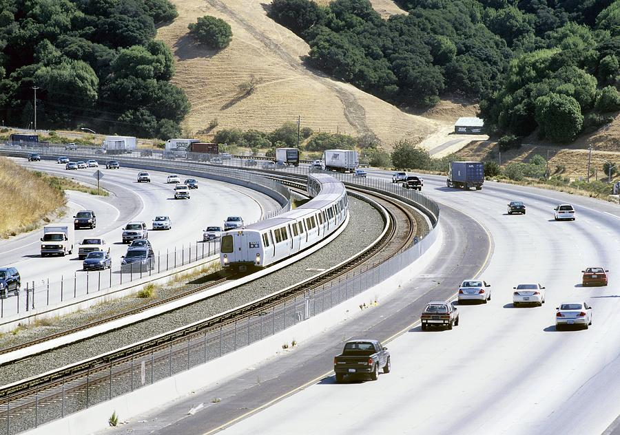 Train And Motorway, California, Usa Photograph