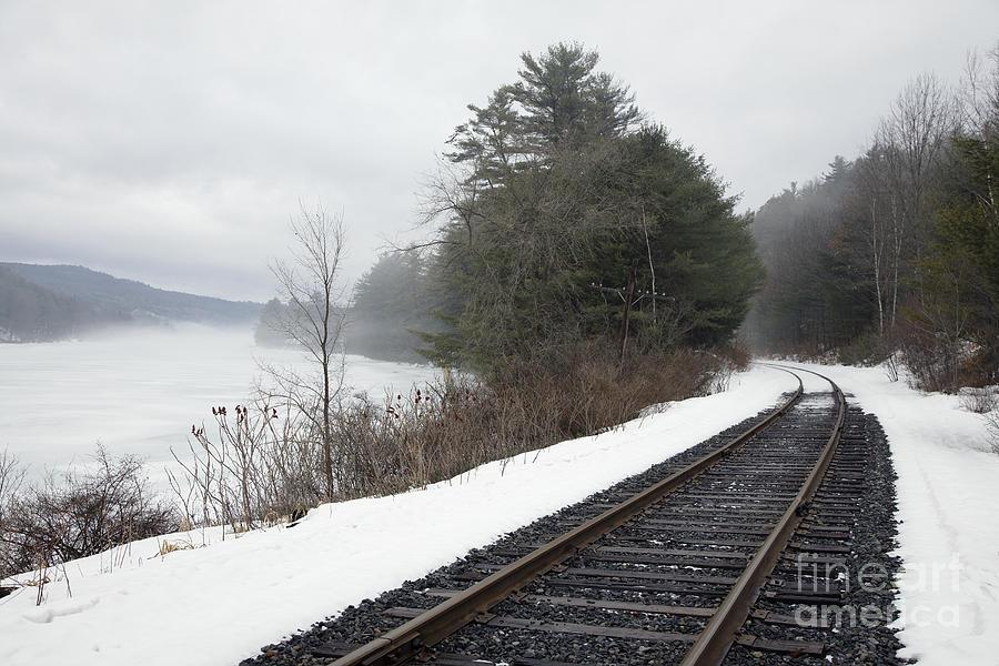 Train Tracks In Snowy Landscape Photograph