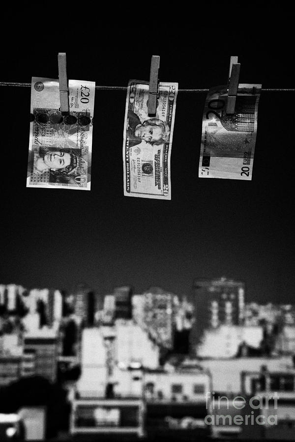 Twenty Pounds Dollars Euro Banknotes Hanging On A Washing Line With Blue Sky Over City Skyline Photograph