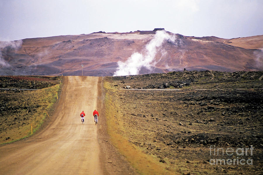 Two Bikers On A Dirt Road Leading To A Geothermal Power Station At Myvatn Photograph  - Two Bikers On A Dirt Road Leading To A Geothermal Power Station At Myvatn Fine Art Print