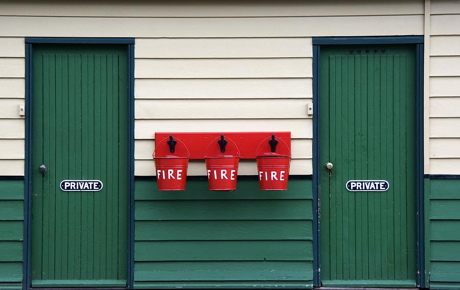 Two Doors And Buckets For Fire Photograph By John Short