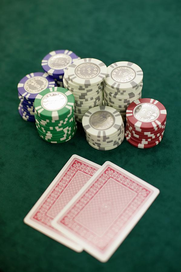 Two Playing Cards And Piles Of Gambling Chips On A Table, Las Vegas, Nevada Photograph