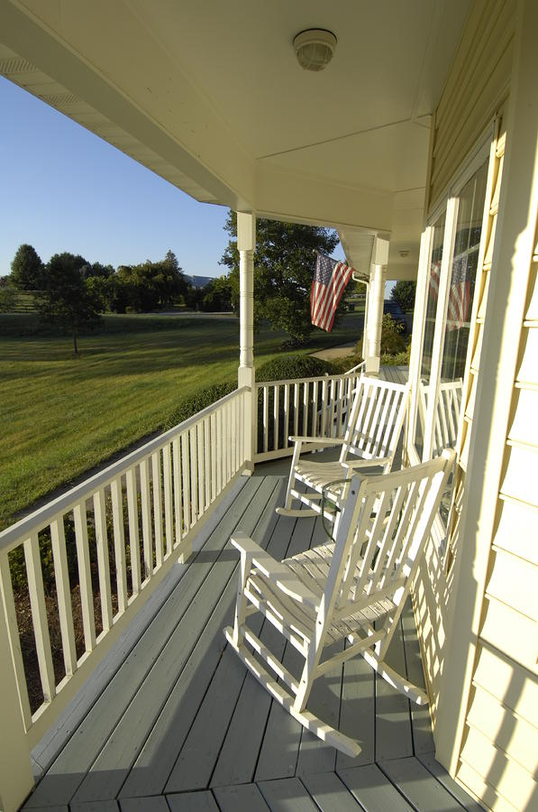 Chairs Photograph - Two Rocking Chairs On A Sunlit Porch by Scott Sroka