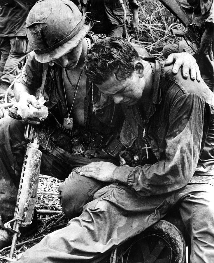 Two Soldiers Comfort Each Other Photograph