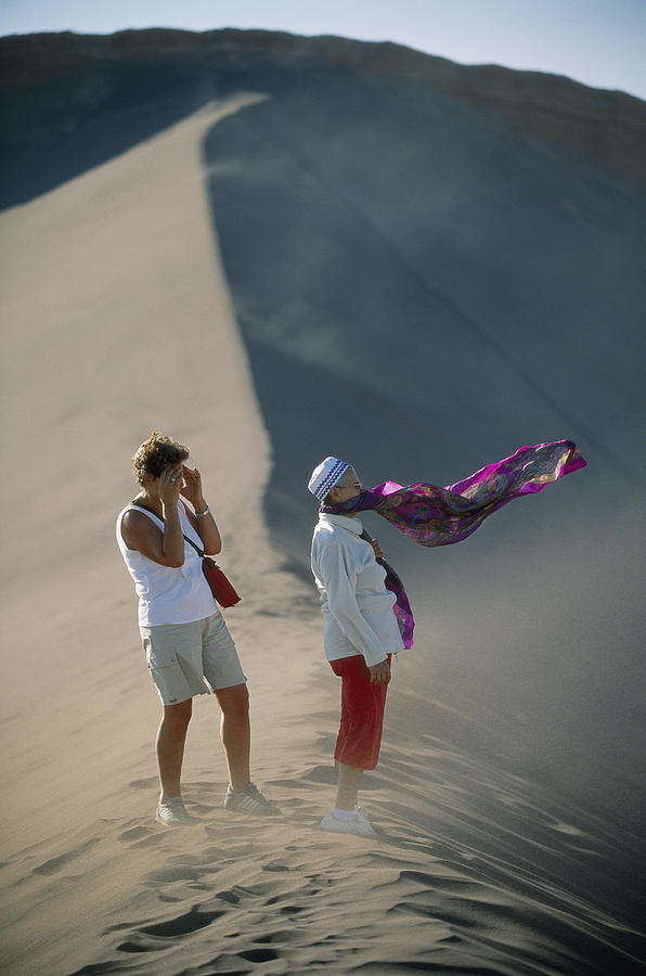 Two Tourist Are Transfixed Photograph