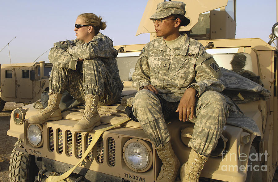 Two U.s. Army Soldiers Relax Prior Photograph