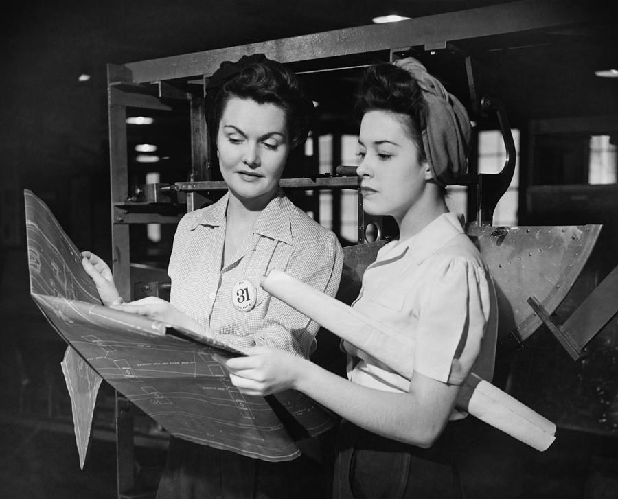 Two Women In Workshop Looking At Blueprints, (b&w) Photograph