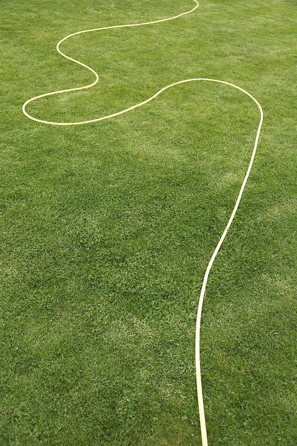 Uk, England, Oxford, Garden Hose On Grass Photograph
