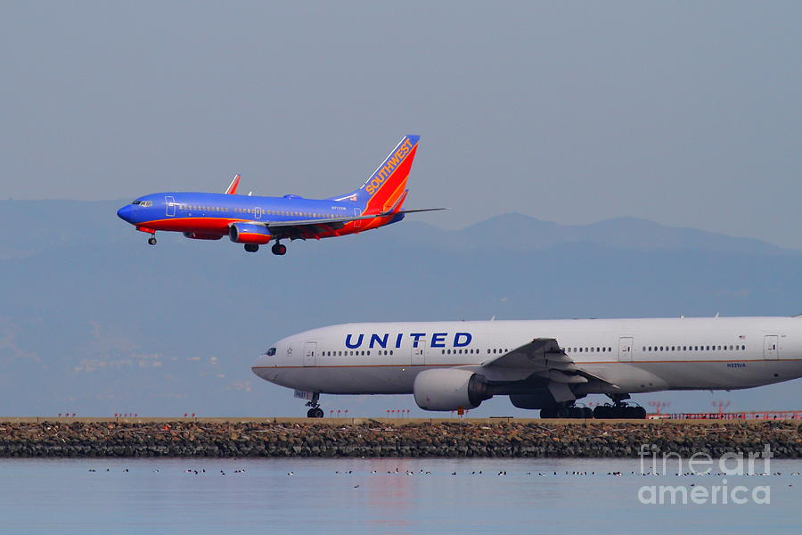 United Airlines And Southwest Airlines Jet Airplane At San Francisco International Airport Sfo.12087 Photograph  - United Airlines And Southwest Airlines Jet Airplane At San Francisco International Airport Sfo.12087 Fine Art Print