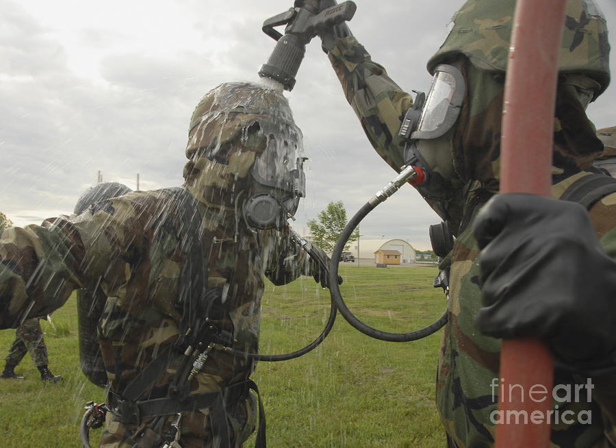 U.s. Air Force Soldier Decontaminates Photograph  - U.s. Air Force Soldier Decontaminates Fine Art Print