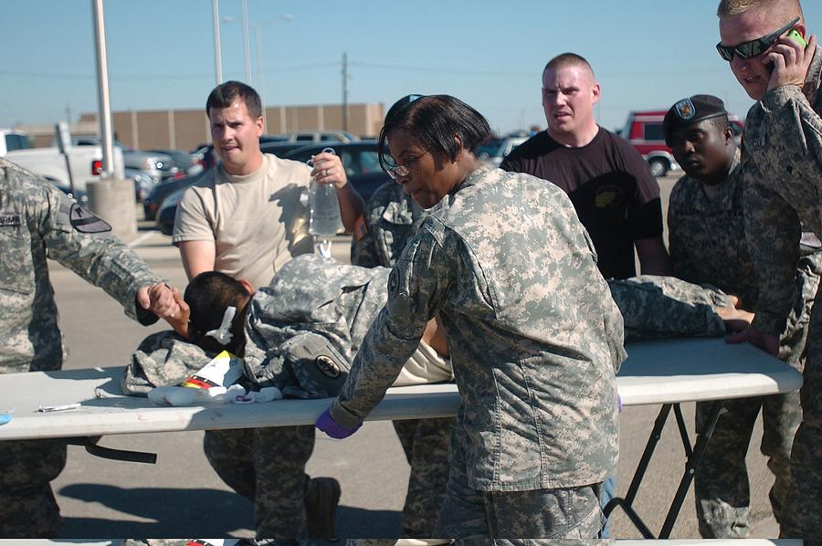 Us Army First Responders Use A Table Photograph