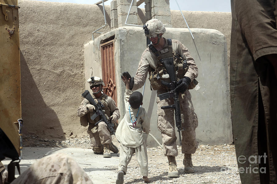 Afghanistan Photograph - U.s. Marine Gives An Afghan Child by Stocktrek Images