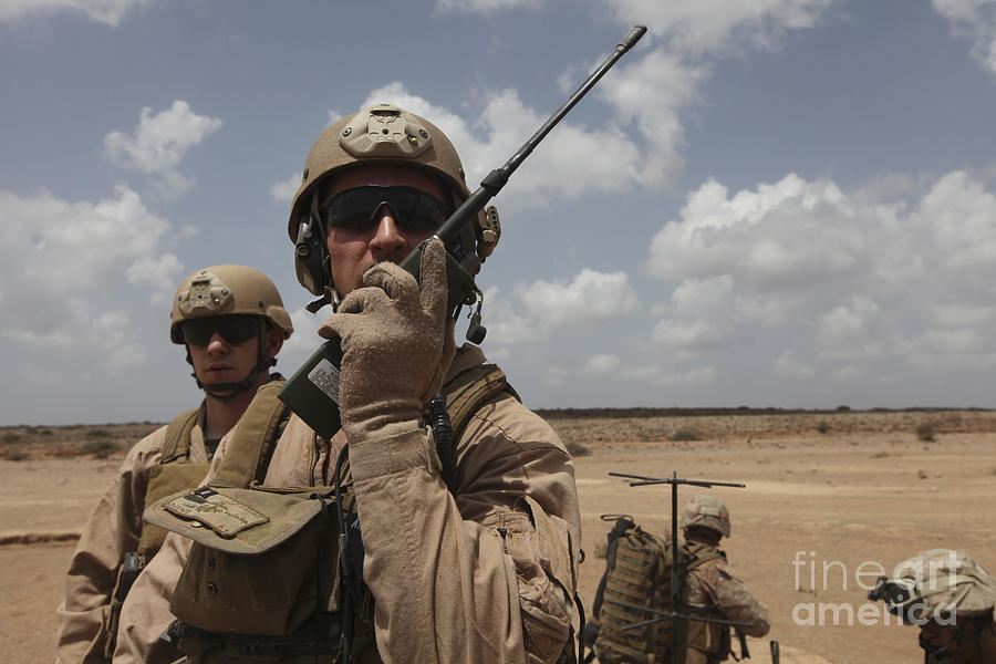 U.s. Marine Uses A Radio In Djibouti Photograph