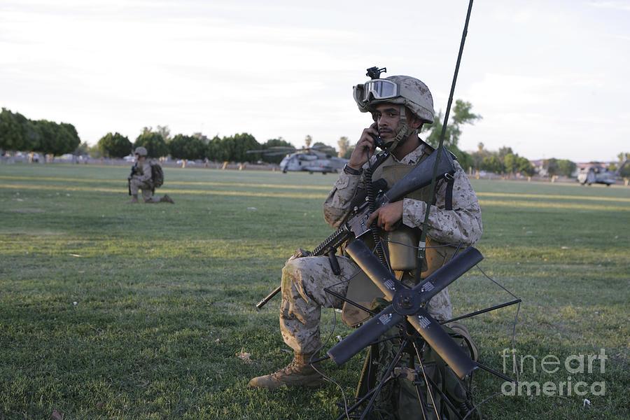 U.s. Marine Utilizes A Satellite Radio Photograph