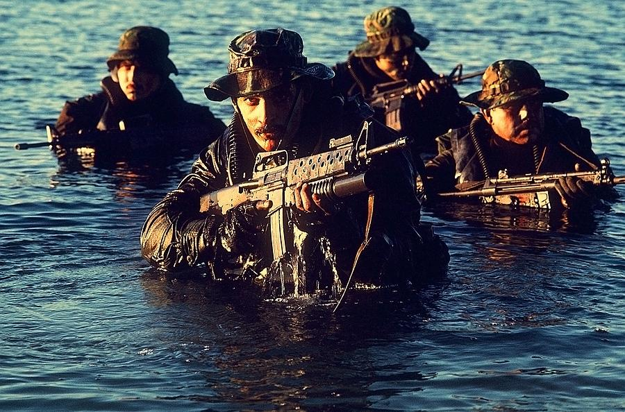 Us Navy Seal Team Emerges From Water Photograph