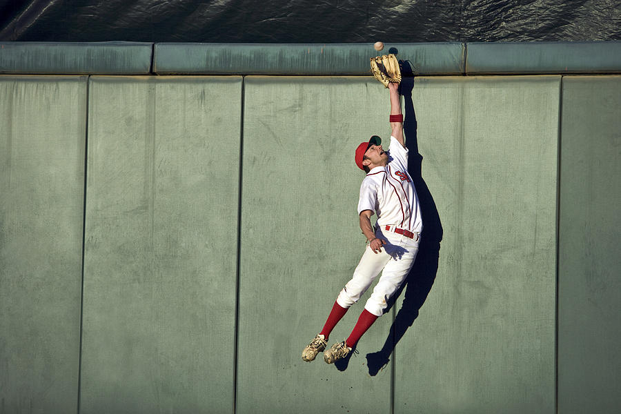 Usa, California, San Bernardino, Baseball Player Making Leaping Catch At Wall Photograph  - Usa, California, San Bernardino, Baseball Player Making Leaping Catch At Wall Fine Art Print