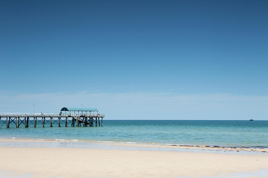 View Of A Pier From A Sandy Beach Photograph