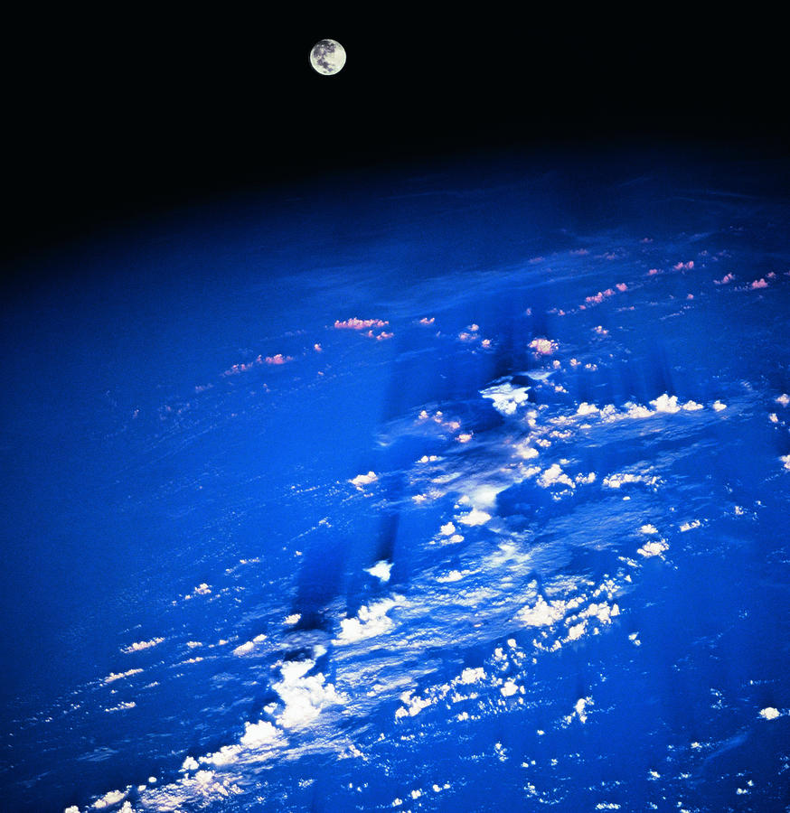 View Of The Moon Above The Earth Photograph