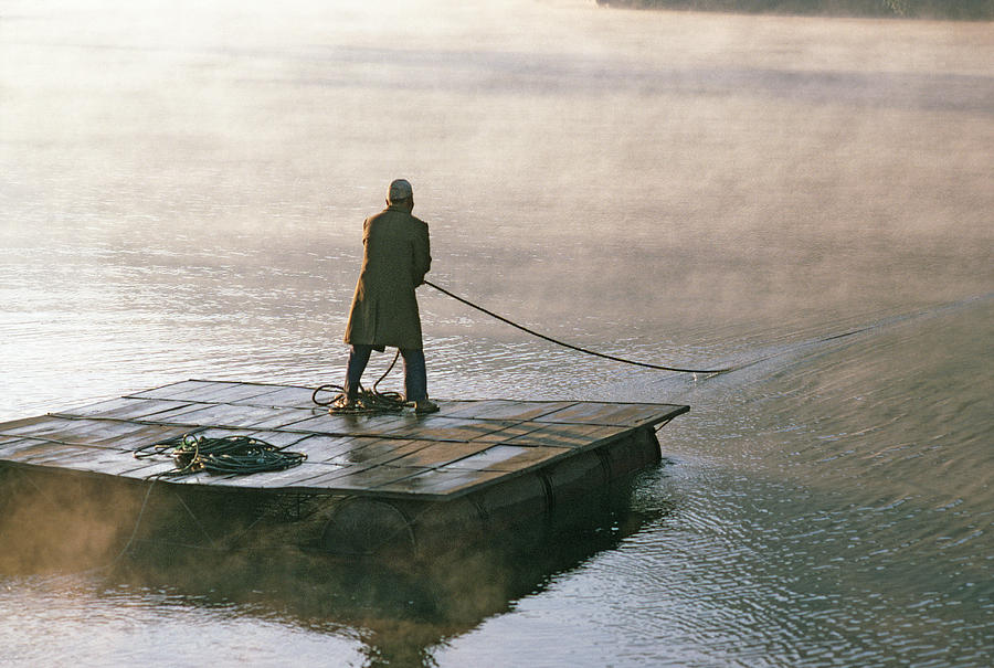 Villager On Raft Crosses Lake Phewa Tal Photograph