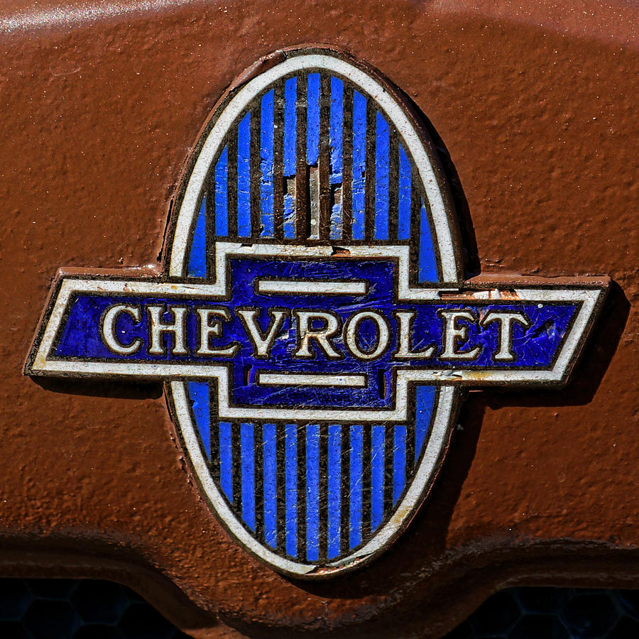 vintage chevrolet emblem photograph by alan hutchins