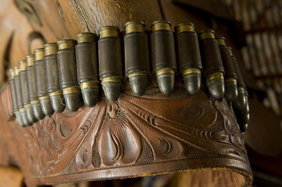 Vintage Holster And Bullets Photograph