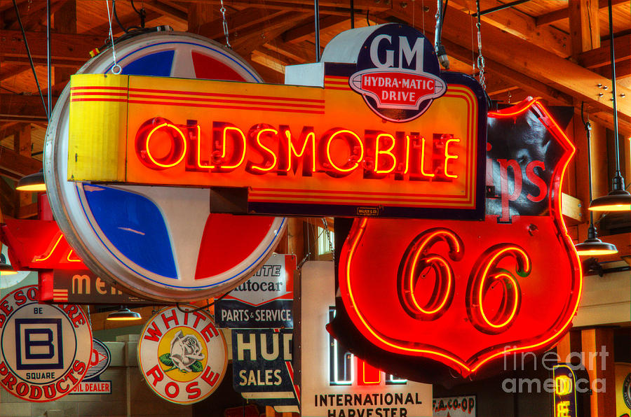 Classic Signs Photograph - Vintage Neon Sign Oldsmobile by Bob Christopher
