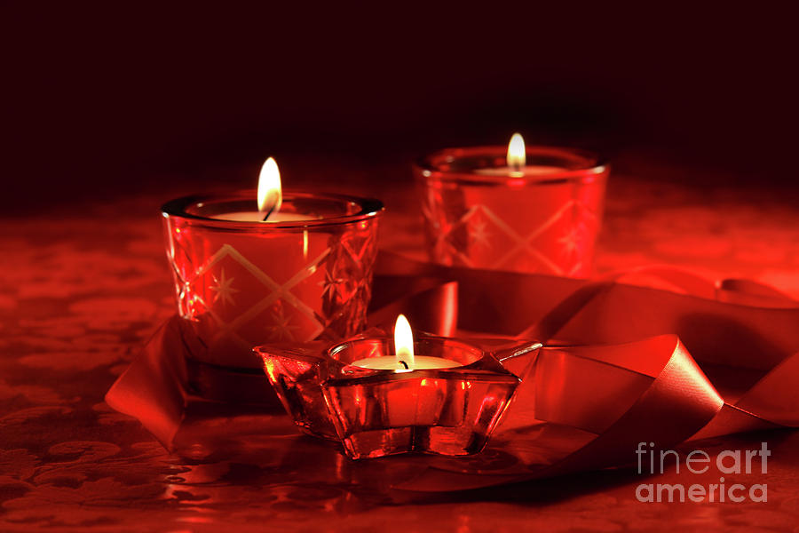 Votive Candles On Dark Red Background Photograph