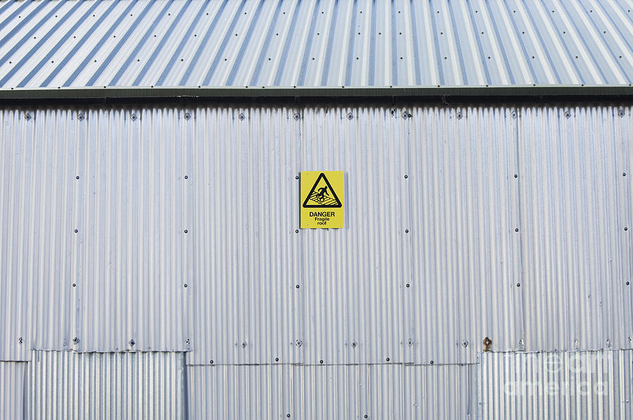 Warning Sign On An Industrial Building Photograph