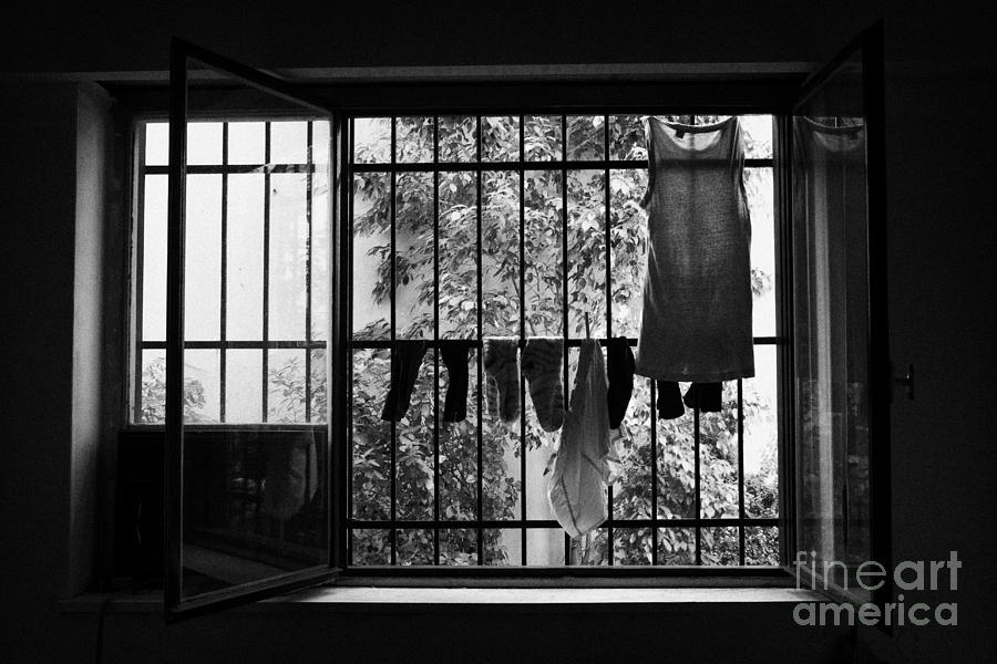 Washing Hanging Off Security Cage In An Apartment In Buenos Aires Photograph