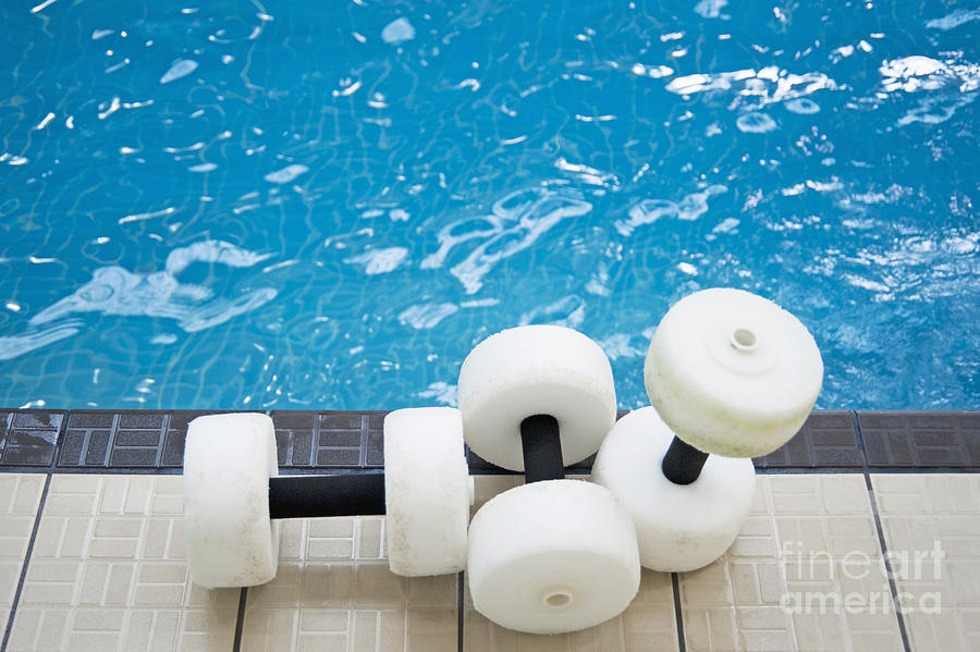 Water Floats At Poolside Photograph