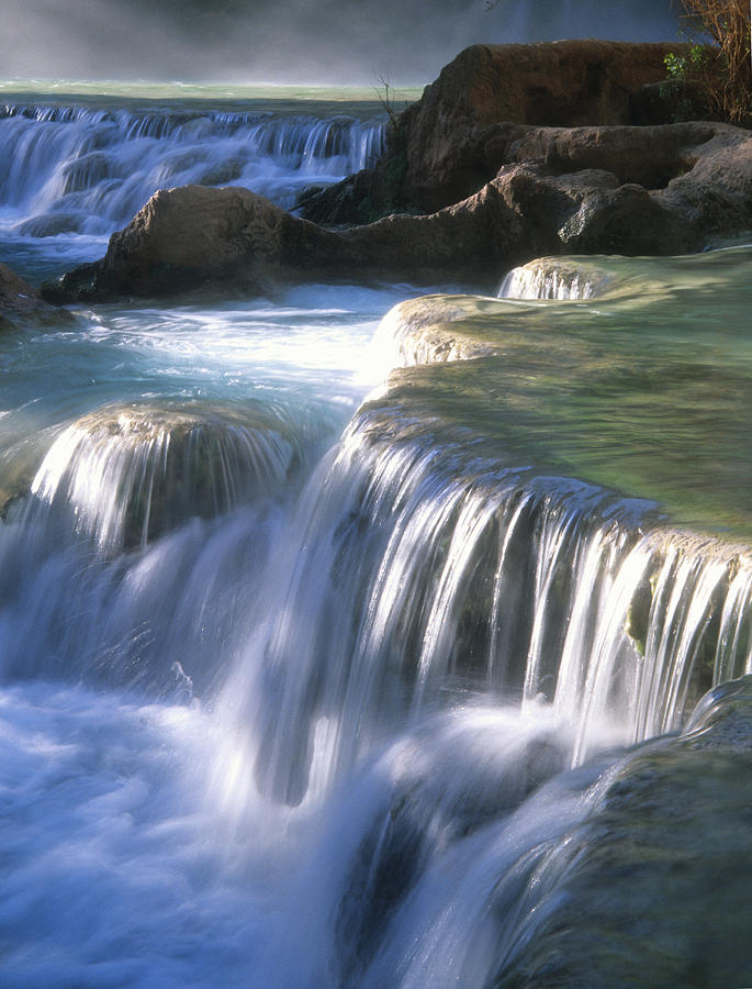 Water Flowes Over Travertine Formations Photograph