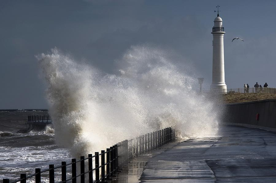 Building Exterior Photograph - Waves Crashing By Lighthouse At by John Short