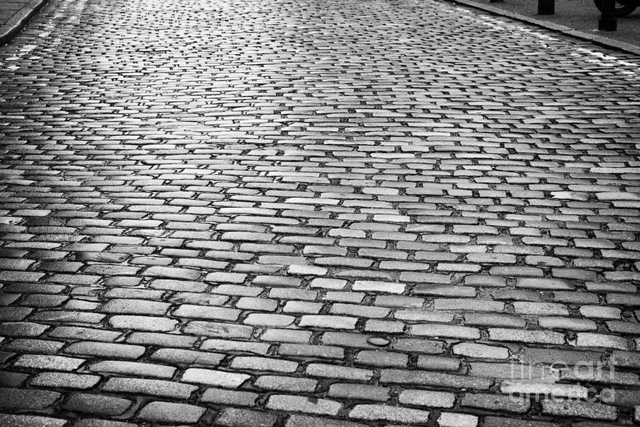 Wet Photograph - Wet Cobblestoned Huntly Street In The Union Street Area Of Aberdeen Scotland by Joe Fox