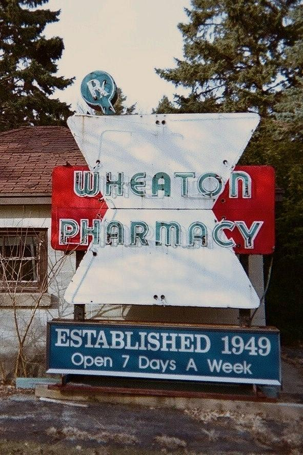 Old Neon Sign Photograph - Wheaton Pharmacy by Todd Sherlock