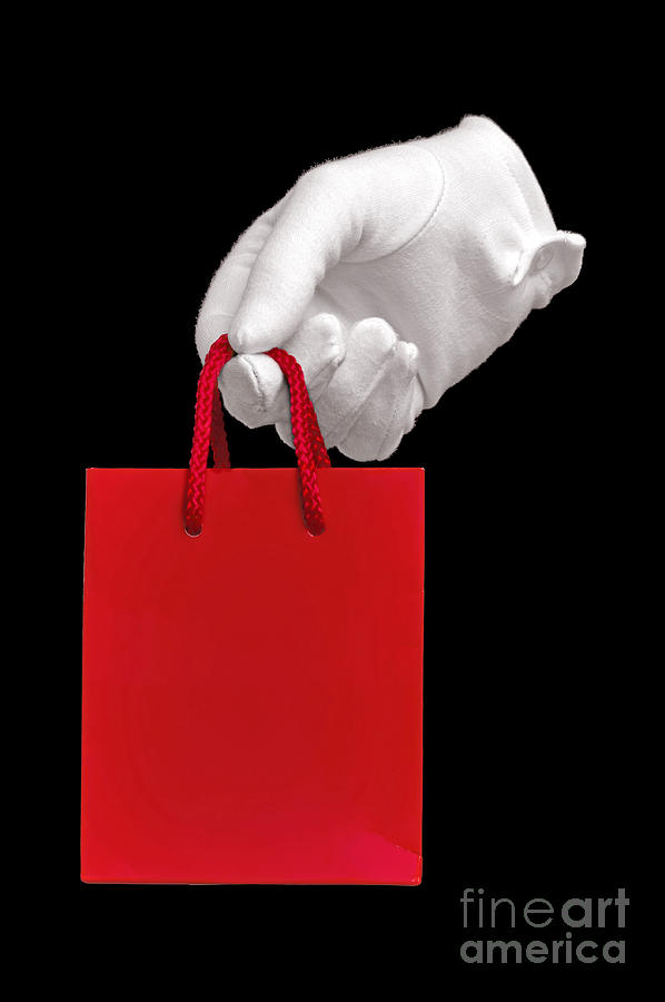 White Glove Holding A Red Gift Bag Photograph  - White Glove Holding A Red Gift Bag Fine Art Print