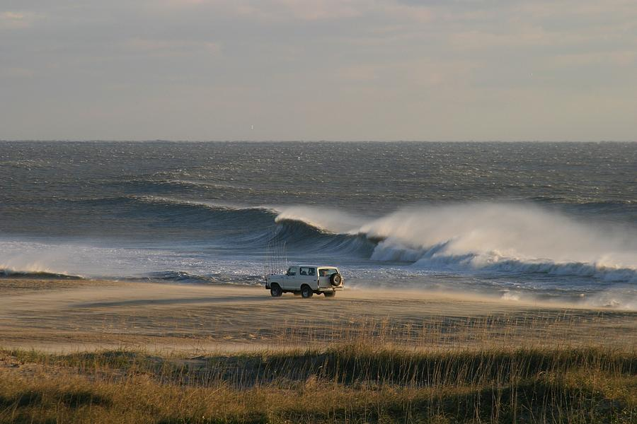Wind, Waves And Fisherman In An Suv Photograph