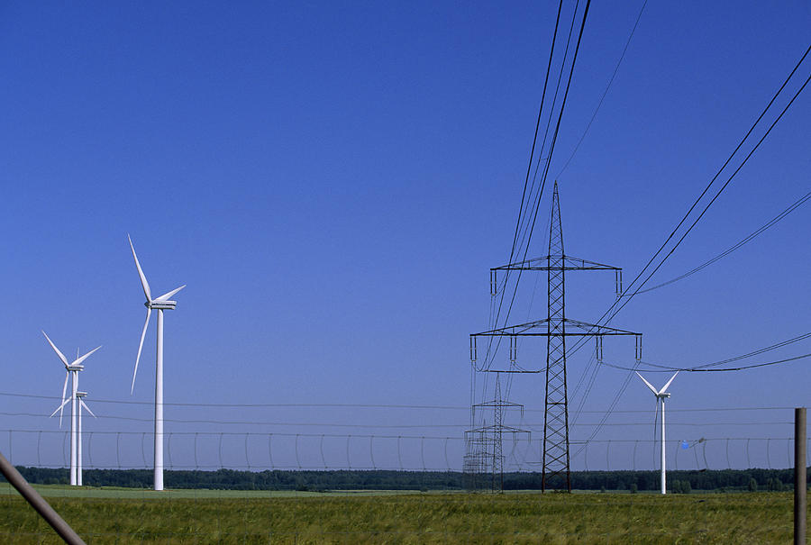 Windmills And High Voltage Transmission Photograph