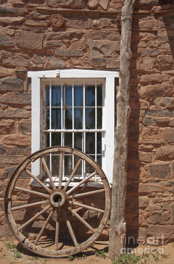 Window In Stone Building With Wagon Wheel Photograph  - Window In Stone Building With Wagon Wheel Fine Art Print