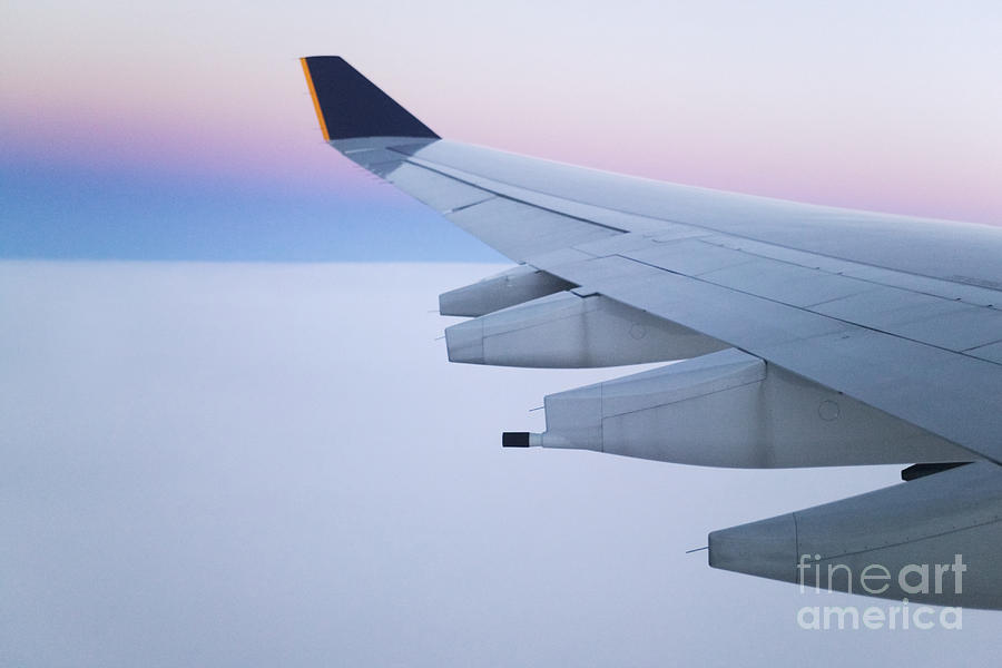 Wing And Engines Of Jet In Flight Photograph