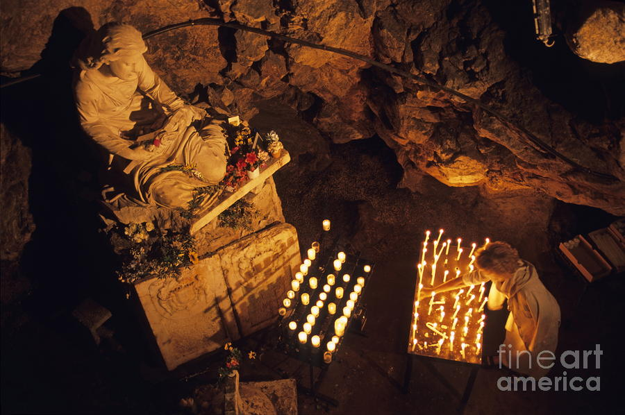 Woman Burning Candle At Troglodyte Sainte-marie Madeleine Holy Cave Photograph