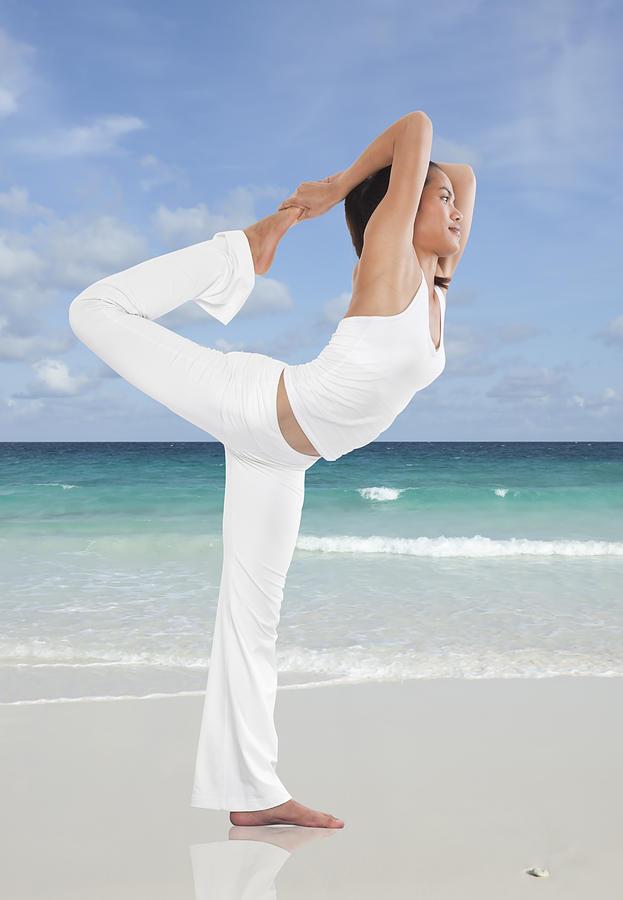 Action Photograph - Woman Doing Yoga On The Beach by Setsiri Silapasuwanchai