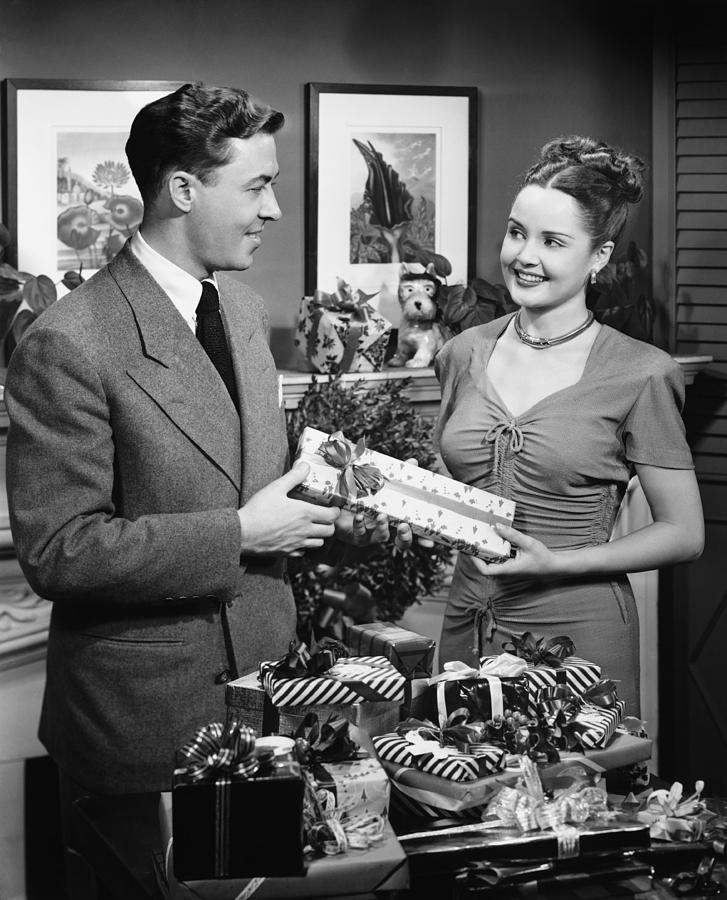 Woman Giving Gift To Man, (b&w) Photograph