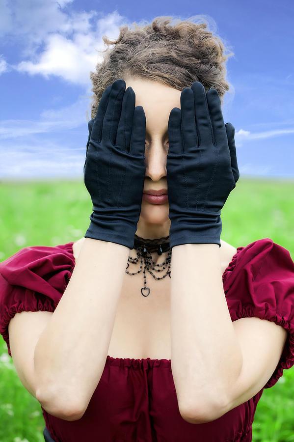 Woman Hiding Photograph