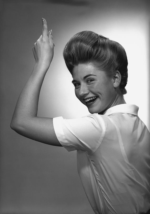 35-39 Years Photograph - Woman Pointing Up In Studio, (b&w), Portrait by George Marks