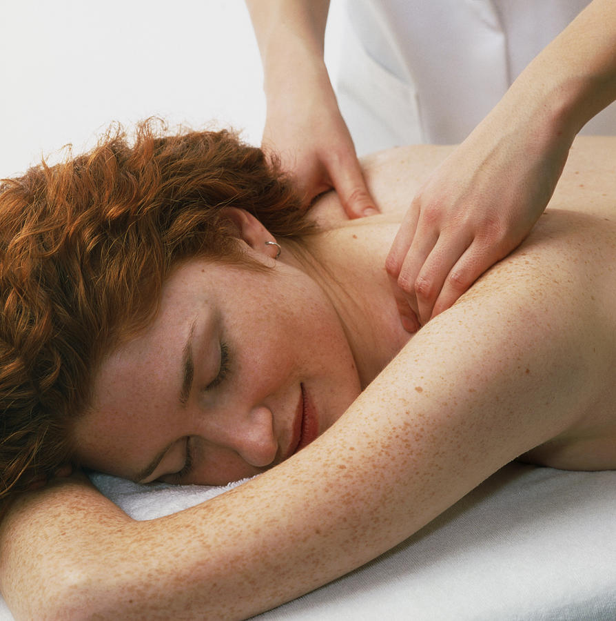 Woman Receives A Neck And Shoulder Massage Photograph  - Woman Receives A Neck And Shoulder Massage Fine Art Print