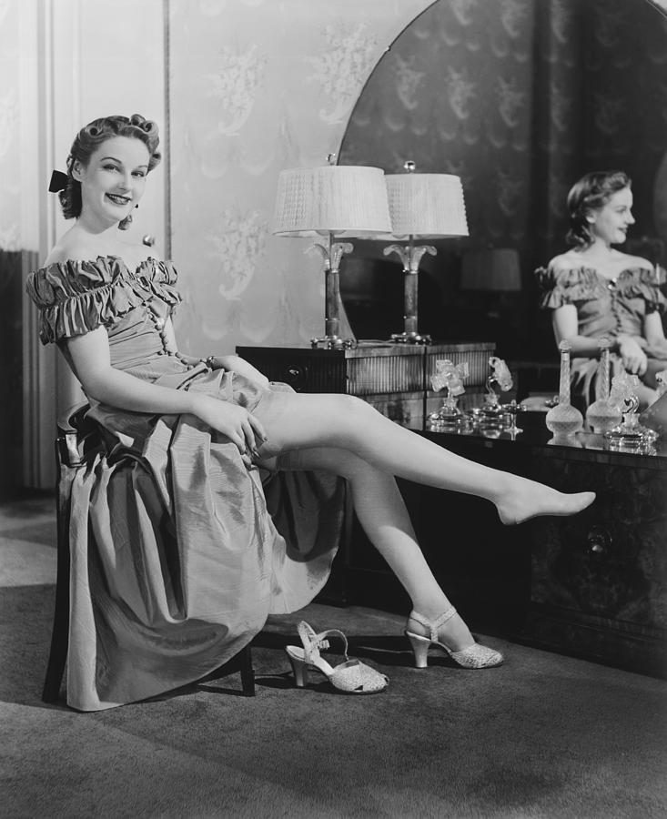 Woman Sitting At Vanity Table, Putting On Stockings, (b&w), Portrait Photograph  - Woman Sitting At Vanity Table, Putting On Stockings, (b&w), Portrait Fine Art Print