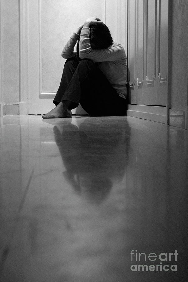 Woman Sitting In Corridor With Head In Hands Photograph