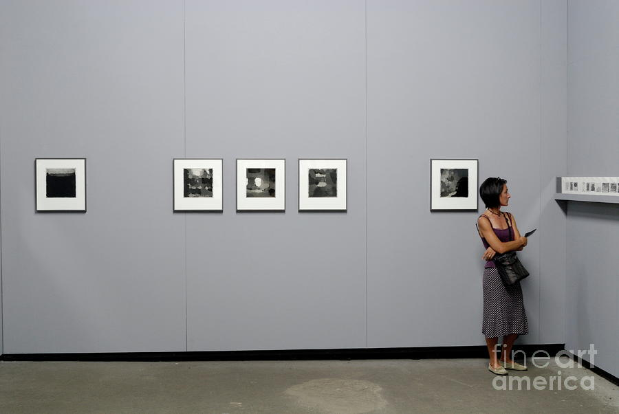 Woman Watching Photos At Exhibition Photograph  - Woman Watching Photos At Exhibition Fine Art Print