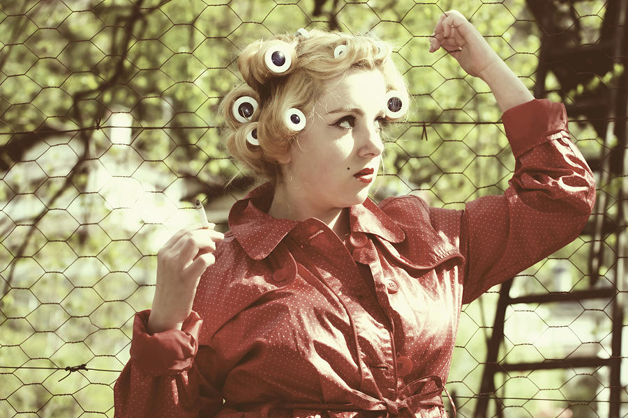 Woman With Rain Coat And Curlers Photograph