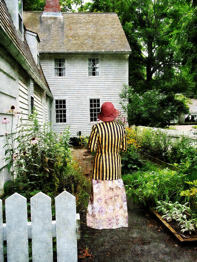 Woman With Striped Jacket And Flowered Skirt Photograph